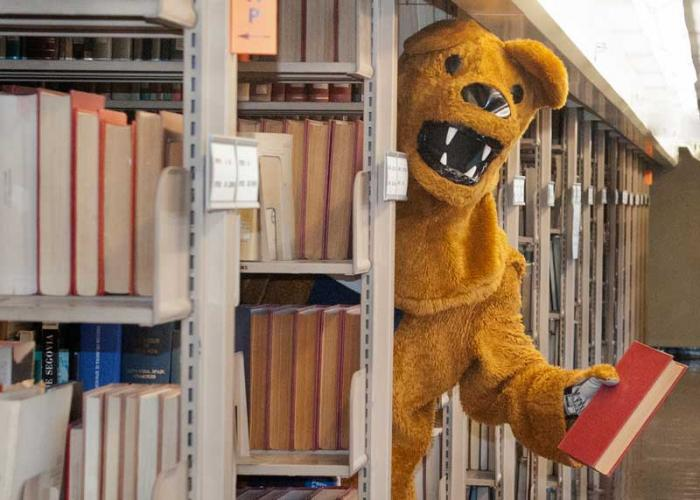 The Nittany Lion offers a book