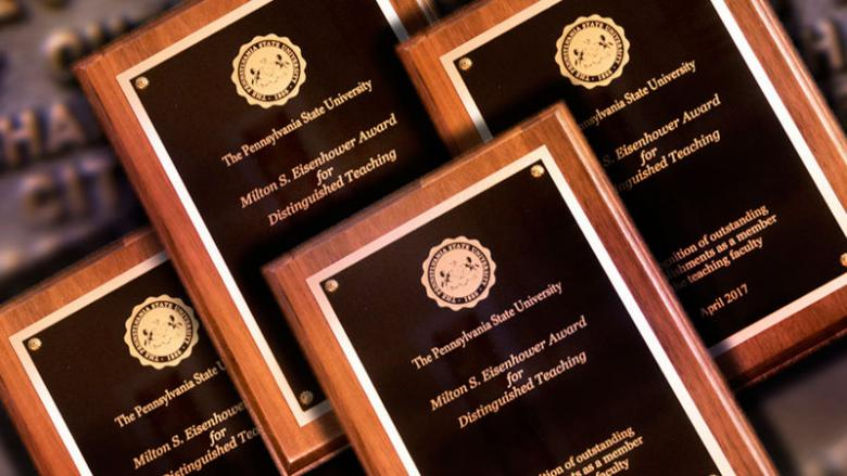 Stack of faculty award plaques